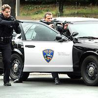 Santa Cruz Police take a suspect into custody in the Washington Mutual Bank parking lot on Ocean Street.<br /> Photo by Shmuel Thaler <br /> shmuel_thaler@yahoo.com www.shmuelthaler.com