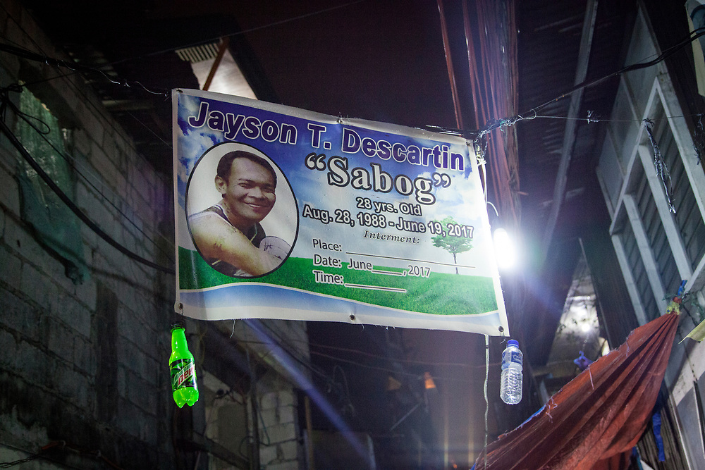 """A banner for the wake of Jayson """"Saybog"""" Descartin who was recently killed.  His death was related to the drug war.<br /> <br /> Over 12 thousand people including men, women and even young teens who are mostly the urban poor, have been killed since President Duterte initiated the campaign against drugs. The killings or executions are carried out by masked gunmen. Bodies in morgue showed signs that the victims were bound or handcuffed but the police report often states they fought back or tried to run away."""