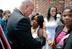 07 September 2013. New Hope Baptist Church. New Orleans, Louisiana. <br /> Mayor Mitch Landrieu comforts Andrea Samuels (mother of victim) when attends the funeral service for 1 year old toddler Londyn Unique Reed Samuels, shot to death August 29th.  The infant Londyn was shot by thugs whilst in the arms of her babysitter, the intended victim who was holding Londyn whilst walking down the street at the time of the assault. NOPD has arrested 2 men in connection with the heinous crime.<br /> Photo; Charlie Varley
