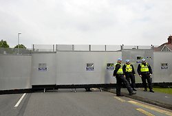 © Licensed to London News Pictures. 04/09/2014. Bristol, UK.  The police steel barrier by Celtic Manor, at the protest march through Newport against the NATO summit being held at The Celtic Manor resort at Newport. Photo credit : Simon Chapman/LNP