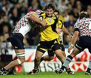 Dane Coles tackled by Kane Douglas<br />Super 14 rugby union match, Waratahs vs Hurricanes, Sydney, Australia. <br />Saturday 14 May 2010. Photo: Paul Seiser/PHOTOSPORT