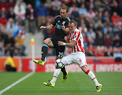 Craig Dawson of West Bromwich Albion (L) and Glenn Whelan of Stoke City in action - Mandatory by-line: Jack Phillips/JMP - 24/09/2016 - FOOTBALL - Bet365 Stadium - Stoke-on-Trent, England - Stoke City v West Bromwich Albion - Premier League
