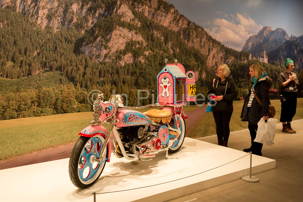 Visitors to the Grayson Parry exhibition entitled The Most Popular Art Exhibition Ever! admire his pink motorbike teddy bear pilgrimage, on 5th November 2017, at the Arnolfini, Bristol, England.