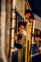 Boys hanging out windows on the narrow gauge railroad from Kalka to Shimla (Himachal Pradesh), India