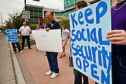 06 APRIL 2011 - PHOENIX, AZ: Picketers at the Social Security offices on N 7th Ave in Phoenix Wednesday. A handful of people attended the picket, which was organized by Strengthen Social Security, Alliance for Retired Americans and AFGE (American Federation of Government Employees). The picket was held to draw attention to the importance of Social Security in advance of an expected government shutdown later this week. Similar events were held across the country.    PHOTO BY JACK KURTZ