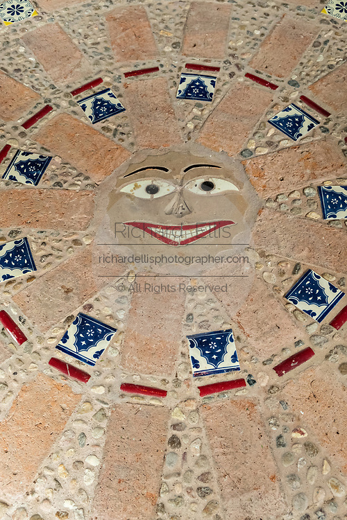Multi layered assemblage art embedded on the ground of the Chapel of Jimmy Ray by American artist Anado McLauchlin in his compound Casa las Ranas September 28, 2017 in La Cieneguita, Mexico.