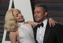 July 19, 2016 - Beverly Hills, California, U.S - Lady Gaga and Fiancé Taylor Kinney have reportedly broken up after five years, Tuesday July 19, 2016. FILE PHOTO: Lady Gaga and Fiancé Taylor Kinney on the red carpet at the 2016 Vanity Fair Oscar Party held at the Annenberg Center in Beverly Hills, California, Sunday February 28, 2016. (Credit Image: © Prensa Internacional via ZUMA Wire)