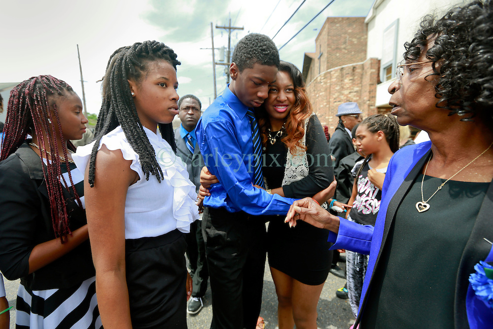 14 May 2014. New Orleans, Lousiana. <br /> Lamichael Jackson (blue shirt), 15 yrs is devastated to attend the funeral of his 14 year old brother Miqual Jackson at the New Hope Baptist Church. Miqual Jackson was shot in the back of the head May 5th and died shortly afterwards. Surviving brother Lamichael was shot in the leg. 52 year old Gregory Johnson is wanted on 1st degree murder charges. Randy Pittman, 49, an associate of Johnson's was arrested on 3 counts of being a principal to 1st degree murder. The New Hope Baptist Church witnessed the funeral of 1 year old Londyn Samuels who was also gunned down in cold blood on the streets of New Orleans 8 months ago..<br /> Charlie Varley/varleypix.com