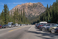 Vehicles overfllowing parking area at Rainy Pass. North Cascades Washington
