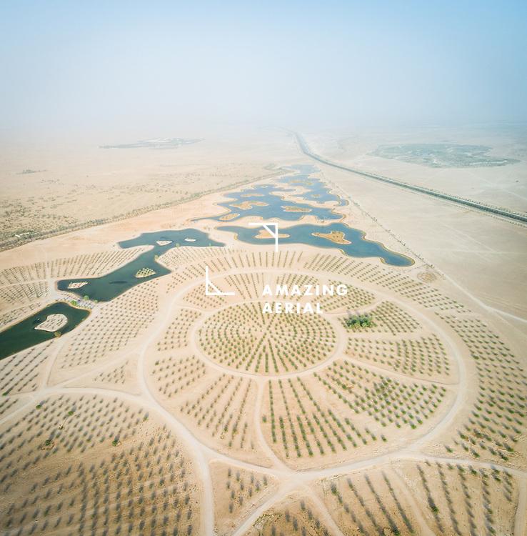 Aerial view of Al Qudra lakes in the middle of Saih Al Salam Desert in Dubai, UAE.