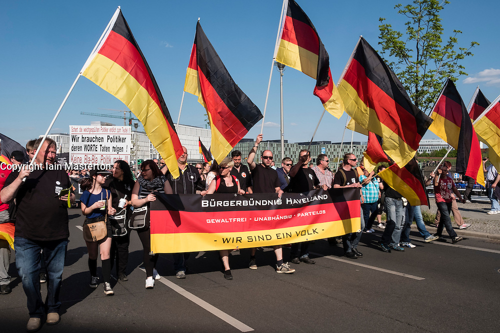 Berlin, Germany. 7th May 2016. Far-right protesters demonstrate against islam, refugees and Angela Merkel in Mitte Berlin. Protestors demanded that Chancellor Angela Merkel stand down because of allowing large numbers of refugees and migrants to enter Germany.