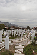 Sarajevo, Bosnia and Herzegovina - October 5, 2013: The Martyrs' Memorial Cemetery Kovači in Saraejvo holds the remains of some of the approximately 11,000 people who were killed during the siege of the city that lasted from 1992 to 1996.
