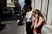 Woman using her mobile phone in the street in Monastiraki. Athens is the capital and largest city of Greece. It dominates the Attica periphery and is one of the world's oldest cities, as its recorded history spans around 3,400 years. Classical Athens was a powerful city-state. A centre for the arts, learning and philosophy.