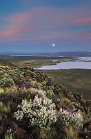 Full moon setting over Warner Lakes Wetlands, seen from Hart Mountain National Antelope Refuge, Oregon