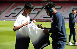 Tottenham Hotspur's Danny Rose signs a shirt for a fan on the pitch before the Premier League match at the Vitality Stadium, Bournemouth.