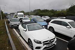 © Licensed to London News Pictures. 27/09/2021. London, UK. traffic builds up as Insulate Britain climate activists block a roundabout over the M25 motorway leading to Heathrow airport. Climate activists have vowed to continue their campaign of disruption despite the government being granted a temporary High Court Injucntion banning the group from protesting on the M25. Photo credit: Peter Macdiarmid/LNP