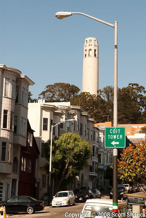 A sign points to the direction of Coit Tower in San Francisco, California.