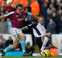 Photo: Daniel Hambury.<br />Tottenham Hotspur v West Ham Utd. The Barclays Premiership. 20/11/2005.<br />Spurs Jermaine Jenas competes with West Ham's Mark Noble.