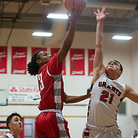 Aron Neely (23) drives to the basket for Bernalillo in their game against Grants Tuesday, Dec. 11, at Grants High School. Bernalillo won 59-41.