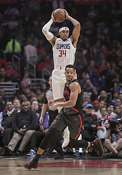 December 17, 2018 - Los Angeles, California, United States of America - Tobias Harris #34 of the Los Angeles Clippers wins the rebound over CJ McCollum #3 of the Portland Trailblazers during their NBA game on Monday December 17, 2018 at the Staples Center in Los Angeles, California. Clippers lose to Trailblazers, 127-131. JAVIER ROJAS/PI (Credit Image: © Prensa Internacional via ZUMA Wire)