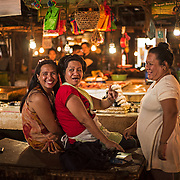 """Indoor market ladies. <br /> <br /> The SARANGANS showcase enormous cultural diversity of Blaan, Tboli, Tagakaolo, Kalagan, Manobo, Ubo, Muslim tribes and Christian settlers. Hospitable and fun-loving """"Sarangans"""" (people of Sarangani) adhere to a unified direction for development.<br /> Muslim consists of 7 groups; the Lumads, 17; and the migrant settlers, at least 20. The Blaans characterize the largest minority and are distributed in the municipalities of Malapatan, Glan, Alabel, Maasim, and Malungon. A bulk of this tribe is found in Malapatan constituting 37% of the municipal household population.<br /> The Maguindanaos are settled in the municipalities of Malapatan, Maitum, and Maasim; Tbolis reside mostly in Maitum, Kiamba, and Maasim while Tagakaolos subsist entirely in Malungon.<br /> Cebuano settlers are found in Glan and Alabel; Ilonggos are situated in Malungon while the Ilocanos live mostly in Kiamba and Maitum.<br /> Thus, Sarangani's mixed population of Cebuano-speaking Blaans and Muslims in the east coast, Ilocano-speaking Tbolis, Manobos and Muslims in the west coast, and Ilonggo-speaking Blaans and Kaolos in the north uplands, is unique and in harmony."""