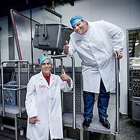 Nederland, Amsterdam, 14 juli 2016.<br /> Een kijkje In de keuken van het familiebdrijf FEBO.<br /> Febo is een snackbarketen in Nederland. De oprichter begon ooit als brood- en banketbakker.<br /> In 1942 werd Maison Febo (oorspronkelijk Bakkerij Febo) opgericht door Johan de Borst (1919-2008). Wat begon als een bakkerswinkel groeide uit tot een automatiek, waar De Borst zelfgemaakte kroketten verkocht.<br /> De naam 'Febo' is afgeleid van de Amsterdamse Ferdinand Bolstraat in de Pijp.<br /> Dagelijks worden de kroketten en burgers nog altijd volgens het authentieke recept van Opa de Borst dagvers bereid. Continu zorgt FEBO ervoor dat de producten nog steeds dezelfde kwaliteit hebben als vroeger.<br /> Dagelijks start FEBO s'ochtends heel vroeg met het maken van een ambachtelijke bouillon gemaakt van verse groenten om vervolgens een ragout te maken van het beste kwaliteitsvlees van 100% Nederlandse runderen uit de buurt. Iedere dag wordt van deze ragout de beroemde FEBO kroket gemaakt. De kroketten zijn dagvers en worden nooit ingevroren.<br /> In 1990 nam zoon Hans de Borst het bedrijf over, later gevolgd door kleinzoon Dennis de Borst.(foto) op de foto met 1 van zijn oudste werknemers.<br /> <br /> Netherlands, Amsterdam, July 14, 2016.<br /> A peek in the kitchen of the family company FEBO.<br /> Febo is a snack bar chain in the Netherlands. The founder started as a baker and confectioner.<br /> In 1942, Maison Febo (originally Bakery Febo) was founded by Johan de Borst (1919-2008). What began as a bakery grew into an automatic, where Johan Borst sold homemade croquettes. <br /> The name 'Febo' derives from the Amsterdam Ferdinand Bolstraat in the Pijp.<br /> The croquettes and meat burgers  are still produced with the authentic recipe of Grandfather Borst and prepared fresh every day. FEBO continuously ensures that the products still have the same quality as before.<br /> FEBO starts very early in the morning with making a bouillon made from fresh vegetables an