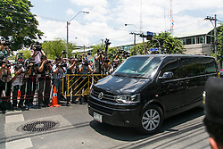 © Licensed to London News Pictures. 23/05/2014. A car reportedly carrying former prime minister Yingluck Shinawatra arrives at the Army auditorium where prominent figures including Yingluck reported to the kingdom's military junta in Bangkok. Thailand's army said on May 23 that 155 prominent figures, including Yingluck and ousted government leaders, were banned from leaving the country without permission following a military coup.  Photo credit : Asanka Brendon Ratnayake/LNP