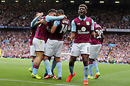 Aaron Tshibola of Aston Villa (8) celebrates after Rudy Gestede of Aston Villa (14) celebrates scores his teams 1st goal. EFL Skybet championship match, Aston Villa v Rotherham Utd at Villa Park in Birmingham, The Midlands on Saturday 13th August 2016.<br /> pic by Andrew Orchard, Andrew Orchard sports photography.