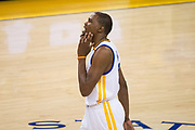 Golden State Warriors forward Kevin Durant (35) rubs his jaw after getting hit in the face during Game 2 of the Western Conference Semifinals against the Utah Jazz at Oracle Arena in Oakland, Calif., on May 4, 2017. (Stan Olszewski/Special to S.F. Examiner)