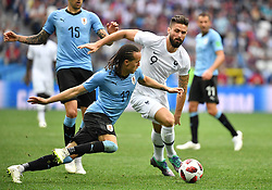 France's Olivier Giroud and Uruguay's Diego Laxalt during the FIFA World Cup 2018 Round of 8 France v Uruguay match at the Nizhny Novgorod Stadium Russia, on July 6, 2018. France won 2-0. Photo by Christian Liewig/ABACAPRESS.COM