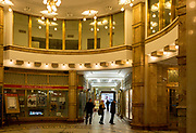 Early-20th-century Czech Rondo-Cubist art deco style architecture in Adria Palace (1925), on 17th March, 2018, in Prague, the Czech Republic. The Palac Adria is situated on the corner of Narodni and Jungmannova street, a famous corner in Prague with an internal passage that connects the two streets. Seek out the elaborate 24-hour clock surrounded by bronze statuettes, representing the signs of the zodiac, in the open foyer. A major reconstruction was done in 1996 and 1997. Today in Palac Adria you will find apartments, office and commercial areas, a theatre club, a gallery and a restaurant.