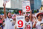 01 MARCH 2013 - BANGKOK, THAILAND: .   Pheu Thai supporters wave placards with 9 on them. 9 is the number of the Pheu Thai Gubernatorial candidate, Pongsapat Pongcharoen, on the ballot. The election is Sunday, March 3 and no campaigning is allowed 24 hours before election day. Police General Pongsapat Pongcharoen (retired), a former deputy national police chief who also served as secretary-general of the Narcotics Control Board is the Pheu Thai Party candidate in the upcoming Bangkok governor's election. He resigned from the police force to run for Governor. Former Prime Minister Thaksin Shinawatra reportedly personally recruited Pongsapat. Most of Thailand's reputable polls have reported that Pongsapat is leading in the race and likely to defeat Sukhumbhand Paribatra, the Thai Democrats' candidate and incumbent. The loss of Bangkok would be a serious blow to the Democrats, whose national base has been the Bangkok area.  PHOTO BY JACK KURTZ