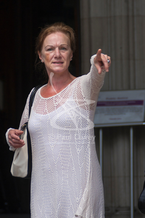 Royal Court of Justice, London, July 9th 2014. Carole Duggan, aunt of Mark Duggan leaves court at lunchtime on day one of the judicial inquiry challenging the inquest verdict on Mark Duggan's shooting by police, in August 2011.