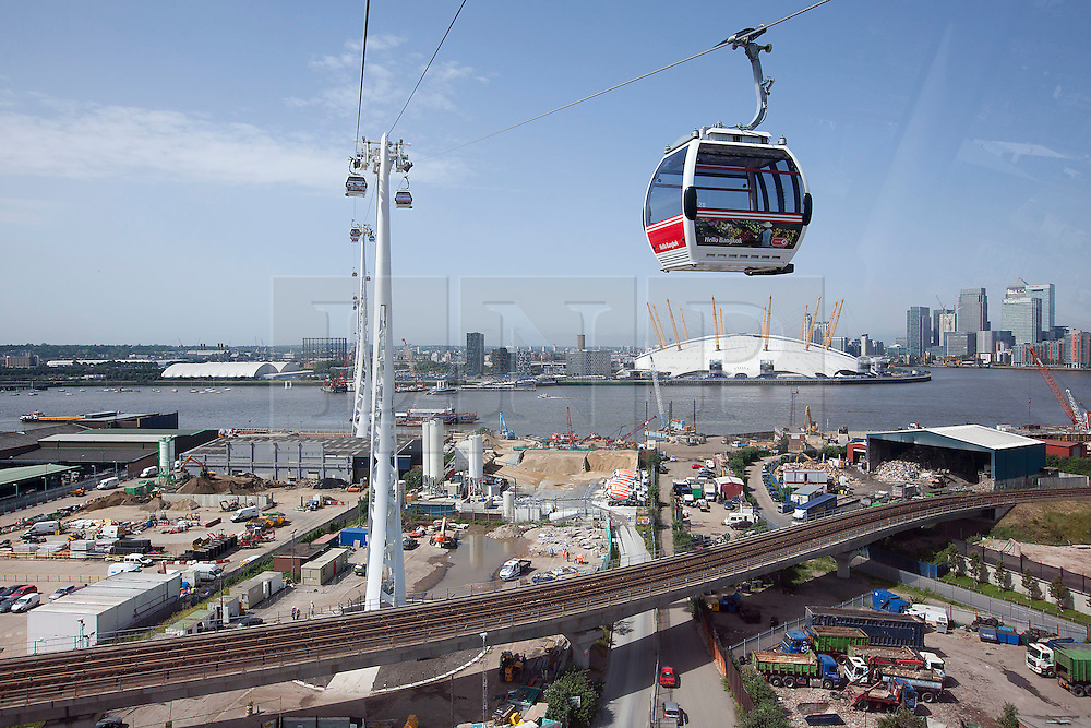 © Licensed to London News Pictures. 28/06/2012. LONDON, UK. Emirates Air-Line cabins are seen in action over East London today (28/06/12) at the launch of London's first cable car system. The new cable car system, running across the River Thames between the Greenwich Peninsula and the Royal Docks in East London, was today opened to the public, despite fears that it would not be ready in time for the London 2012 Olympics. Photo credit: Matt Cetti-Roberts/LNP