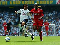 Noureddine Naybet<br />Tottenham Hotspur 2004/05<br />Djibril Cisse Liverpool<br />Tottenham Hotspur v Liverpool (1-1) 14/08/04<br />The Premier League<br />Photo Robin Parker Fotosports International