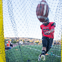 Grants Pirates Demitri Barraza (52) practices his foot placement before the evenings game. Grants faced off against the Taos Tigers in Grants on Friday night.