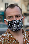 """April, 10th 2020 - Paris, Ile-de-France, France: Parisians wearing a range of masks and facial coverings in the hope of protecting themselves from the spread of the Coronavirus, during the end of the first month of near total lockdown imposed in France. A week after President of France, Emmanuel Macron, said the citizens must stay at home for at least 15 days, that has been extended. He said """"We are at war, a public health war, certainly but we are at war, against an invisible and elusive enemy"""". All journeys outside the home unless justified for essential professional or health reasons are outlawed. Anyone flouting the new regulations is fined. Nigel Dickinson"""