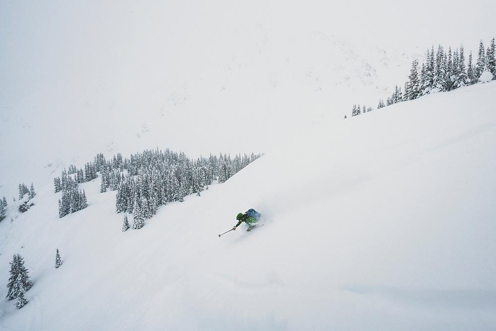 Chris Hassig skiing out the Front Door, Meadow Hut, Esplanade Range, BC.