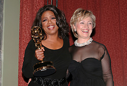 U.S. TV star Oprah Winfrey and Senator Hillary Clinton (D - NY) pose in the pressroom at the 2005 International Emmy Awards Gala held at the Hilton hotel in New York, on Monday November 21, 2005. Photo by Nicolas Khayat/ABACAPRESS.COM