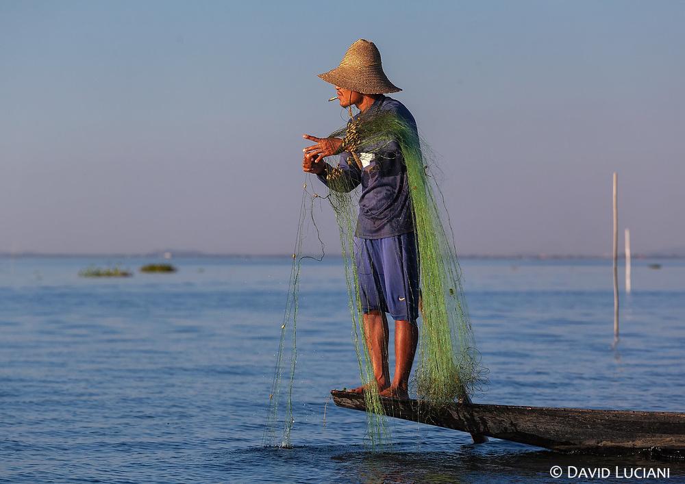 Intha fisherman catching fishes on Inle Lake.