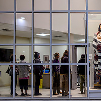 Voters wait in line to cast their ballots at the McKinley County Courthouse in Gallup Tuesday.
