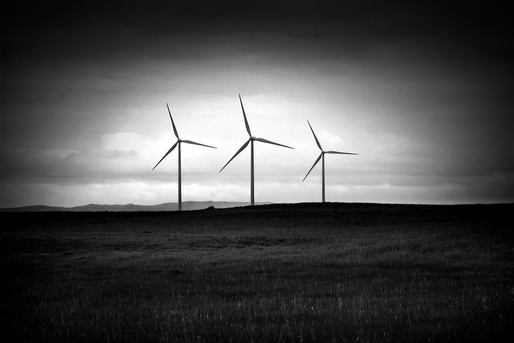 A triplet of wind generators indure a spring storm in Pincher Creek