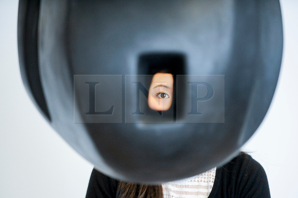 """© Licensed to London News Pictures. 17/02/2017. London, UK.   A staff member looks through """"Lair"""" by Louise Bourgeois, at a preview of """"Traumata: Bourgeois/Kusama"""".  The joint exhibition is dedicated to the work of Louise Bourgeois and Yayoi Kusama, and takes place at Sotheby's S/2 Gallery 23 February to 13 April. Photo credit : Stephen Chung/LNP"""