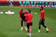 Gareth Bale of Wales (l) jokes with Chris Gunter © during Wales football team training at the Cardiff city Stadium in Cardiff , South Wales on Saturday 8th October 2016, the team are preparing for their FIFA World Cup qualifier home to Georgia tomorrow. pic by Andrew Orchard, Andrew Orchard sports photography