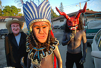 """MEXICO, Veracruz, Tantoyuca, Nov 1- Nov 4, 2009. Making the souls of the dead feel welcome as they return for a yearly visit, Mexicans in this tropical state offer not only elaborate feasts and flower-filled altars, but dancing as well. Masked bands of performers called """"cuadrillos"""" rehearse for months their choreography, rich with symbolic roles for men, women, devils, and death itself, then over the course of two nights regale both graveyards and city streets with whoops of laughter, raise-the-roof dancing and music until dawn. Photographs for HOY by Jay Dunn."""