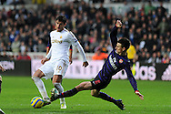 Swansea city's Danny Graham © is blocked by Arsenal's Laurent Koscielny ®  FA cup with Budweiser, 3rd round match, Swansea city v Arsenal at the Liberty Stadium in Swansea, South Wales on Sunday  6th Jan 2013. pic by Andrew Orchard, Andrew Orchard sports photography,