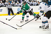 DALLAS, TX - OCTOBER 17:  Jamie Benn #14 of the Dallas Stars takes a shot on goal against the San Jose Sharks on October 17, 2013 at the American Airlines Center in Dallas, Texas.  (Photo by Cooper Neill/Getty Images) *** Local Caption *** Jamie Benn