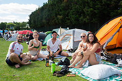 People pictured during day one of the Wimbledon Championships at the All England Lawn Tennis and Croquet Club, Wimbledon. These friends have been camping near the site in the hope of getting tickets to see Roger Federer play. Photo credit should read: Katie Collins/EMPICS