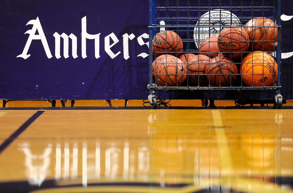Balls sit in a basket before a game between Amherst College and Hamilton College, Friday, Jan. 9, 2015, in Amherst, Mass.  Amherst has broken UConn's women's NCAA record with 104 consecutive home victories and is closing in on the Kentucky men's record of 120-plus wins set decades ago. (Jessica Hill for the New York Times)