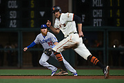 Los Angeles Dodgers first baseman Justin Turner (10) fields a ball as San Francisco Giants right fielder Hunter Pence (8) runs to second base at AT&T Park in San Francisco, California, on April 24, 2017. (Stan Olszewski/Special to S.F. Examiner)